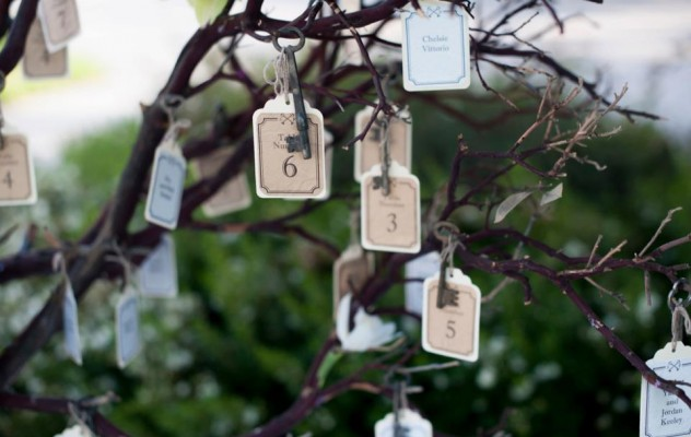 Vintage key escort cards on branches